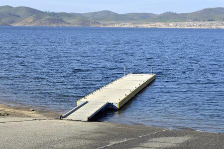 boat dock: Boat dock on the shore of the blue lake in California. Stock Photo