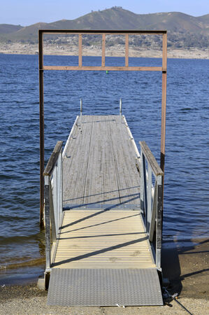 floating bridge: Boat dock on the shore of the blue lake in California. Stock Photo