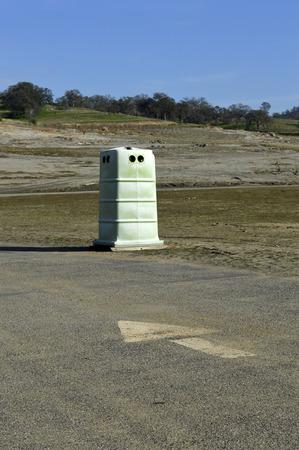 latrine: Plastic public toilet cubicle   outside the field. Stock Photo