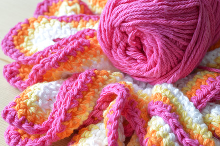 Crochet colored yarn knitted doily beautiful decoration for the home. photo