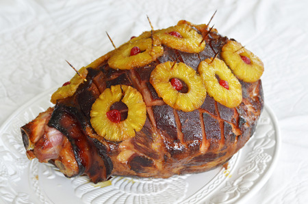 gourmet dinner: Baked ham with honey glaze with pineapple Stock Photo