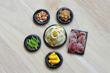 dollhouse: Polymer Clay Food for Dollhouse dinner on the table. Stock Photo