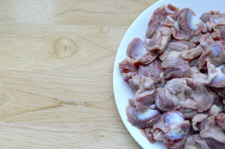 giblets: Chicken giblets on a plate on a chopping board
