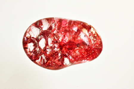 Stones red  crystals on a white background.