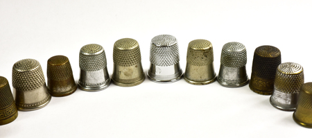 Metal thimbles on white background gold and silver