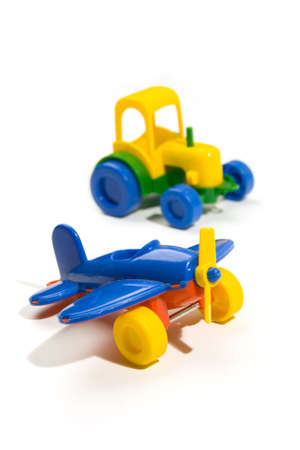 Two toy cars isolated on a white background