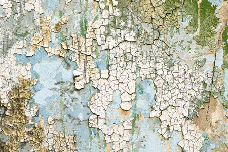 Peeling paint o the wall. Cracked paint background. Banco de Imagens