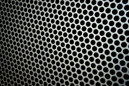 Loudspeaker protective mesh in silvergrey. Stock Photo