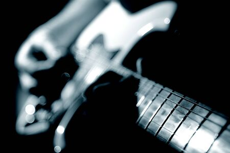 Playing guitar. Guitarist plating a solo. Guitar player in monochrome. Banco de Imagens