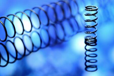 Iron spirals in blur. Shiny metal springs in blur.