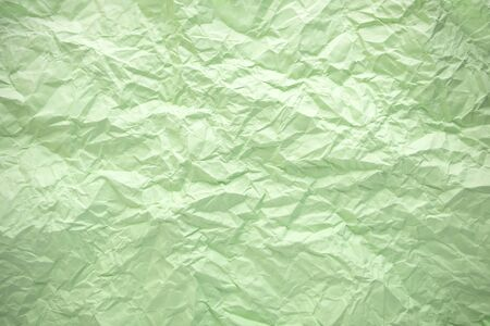 Purple crumpled paper background. Twisted green paper. Seamless pattern. Banque d'images