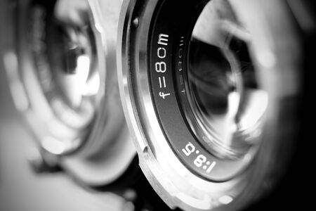Vintage twin reflex camera lens with shallow depth of field in black and white. Retro style medium format camera lens in blur. Vintage film camera lens. Imagens