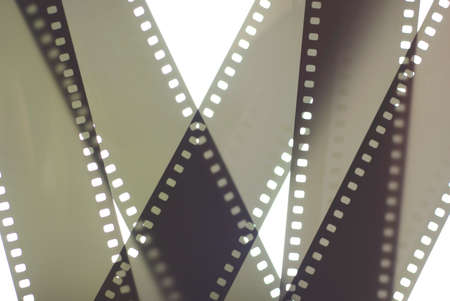 Photographic film background. 35mm negative film tapes on a white background. Analog/film photography background. Stock Photo