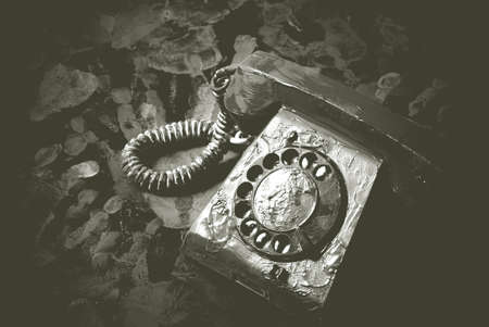 Vintage landline telephone in black and white in blur. Retro dial phone on abstract background.
