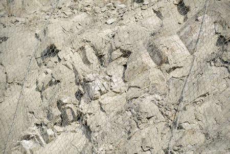 Metal protective mesh on a cliff. Protective grid. 版權商用圖片
