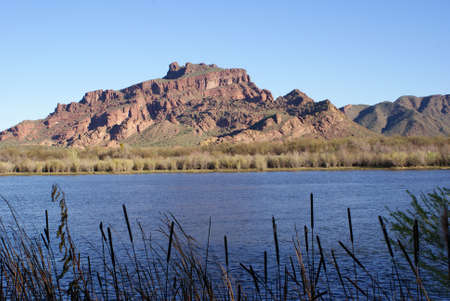 The red mountain as seen from across a lake in Arizona.