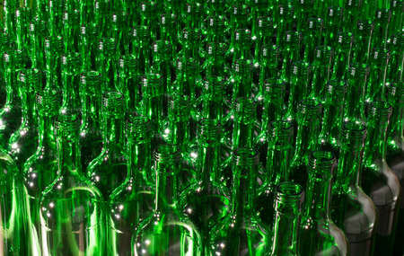 stack of Empty green glass Bottles