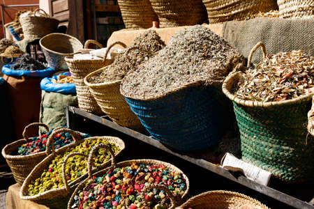 Colorful cooking Spices and flower in traditional local medina bazaar market in Marrakesh, Morocco Banco de Imagens