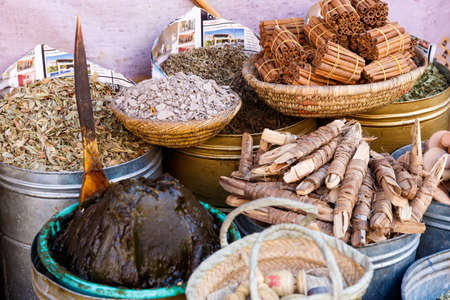 Colorful cooking Spices and flower in traditional local medina bazaar market in Marrakesh, Morocco Editöryel