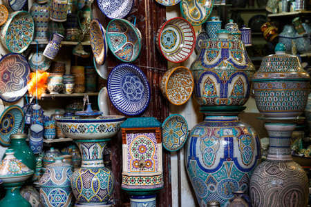 Traditional arabic handcrafted, colorful decorated plates at the bazaar in Marrakesh, Morocco, Africa