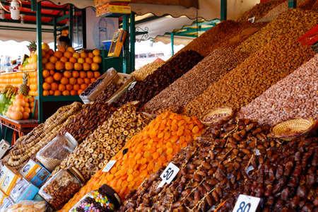 Dried fruit and nuts on market stall at the djemaa el fna square in Marrakesh, Morocco