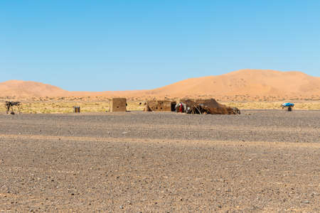a lone nomad tent in the Erg Chebbi, Morocco, a desert landscape that offers an amazing sight of sand and rocks in the Sahara desert Stok Fotoğraf