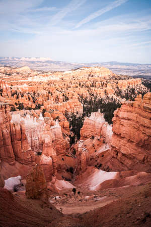 Great spires, also called hoodos, carved away by erosion in Bryce Canyon National Park, Utah, USA, shine red, orange and pastel during sunset. The largest and most famous spire is called Thor's Hammer.