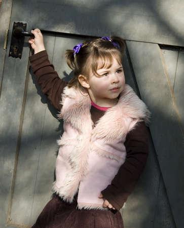 Girl in front of door Stock Photo - 4543892