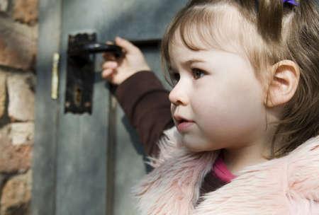 Girl in front of door photo