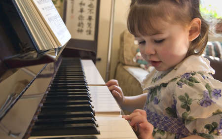 beethoven: Girl playing on the piano Stock Photo