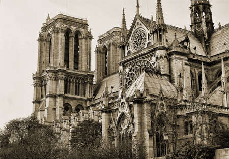 notre: View on the side of Notre Dame in sepia, Paris Stock Photo