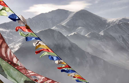 Prayer flags in front of the Yushu mountains, Qinghai province, China Editorial