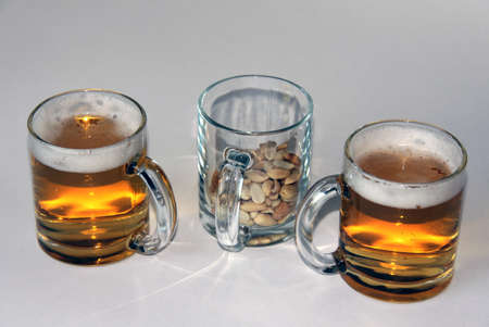 package beer and nuts in glasses for a pleasant stay