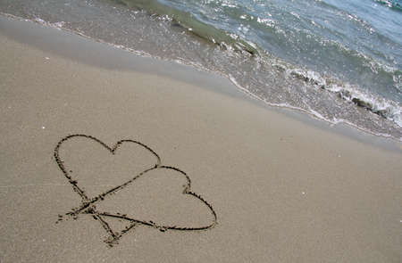 a love letter on the sandy sea beach