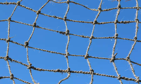 background of a rope net and blue sky