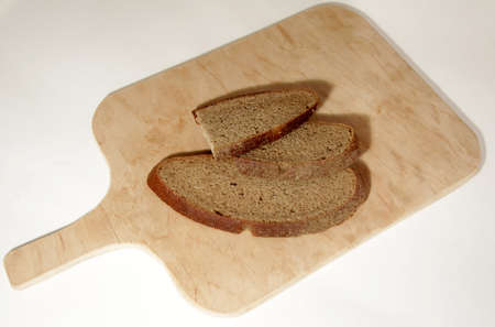 sliced ​​black bread slices on a wooden board