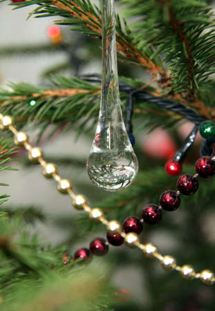 reflection of the holiday decorations in a transparent droplet