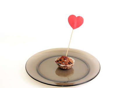 berry muffin on a plate marked with the sign of love