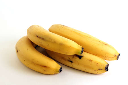 four delicious ripe yellow bananas are together