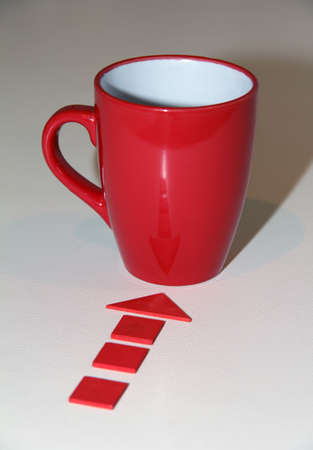 red arrow points to a wooden cup with hot Stock Photo