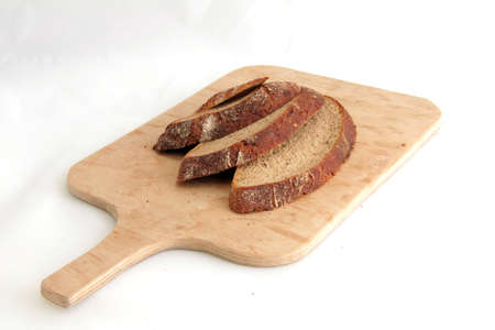 Tasty sliced   8203;  8203;brown bread lying on a wooden board