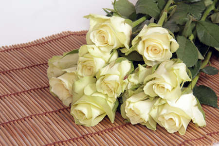 fresh bouquet of delicate white roses on the mat