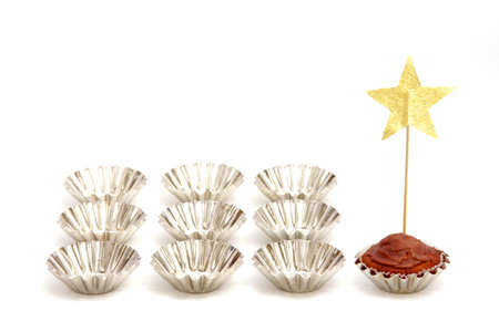 ten empty: the main cake was a star next to the nine blank forms Stock Photo