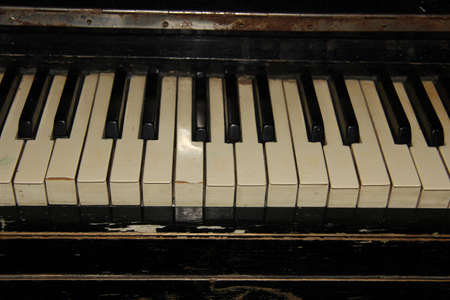 very old piano with traces of long-term use