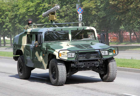 a parade of military equipment, machine with masked men traveling non-stop Editorial