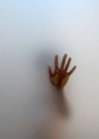 outstretched hand: silhouette emerging from the fog with an outstretched hand Stock Photo