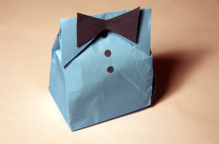 humorous gift in the form of packaging paper suit Stock Photo