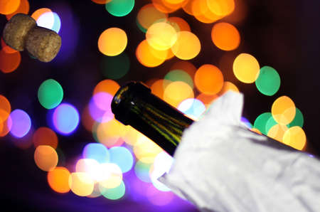 bubbly: bubbly drink shoots on a background of colored lights Stock Photo