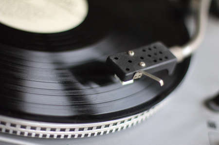retro styled imagery: Retro music player and an old plate vinyl