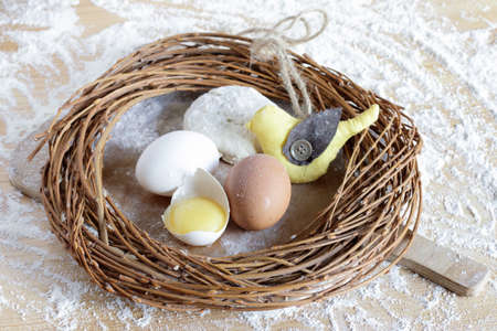 Easter composition with a bird in the nest